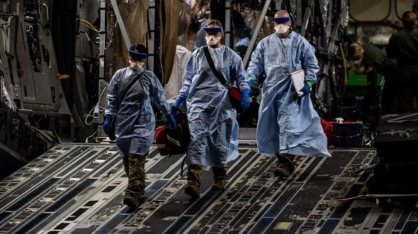 US Airmen Conduct First Aeromedical Evacuation Mission Using Transport Isolation System